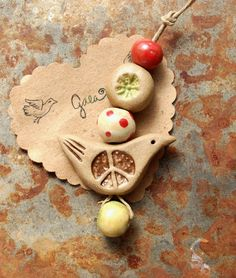 Peace and love… Ceramic peace and love bird in holiday colors. Gaea handmade ceramic design elements and adornments! | gaea.cc
