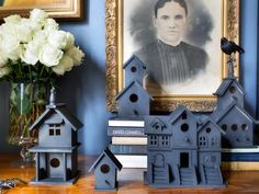 #Halloween decorating:  Tiny Ghost Town.  Matte black spray paint turns craft store birdhouses into an eerie mini landscape. To bump up the creep factor, add oversized spiders, rubber snakes or faux birds to your scene.