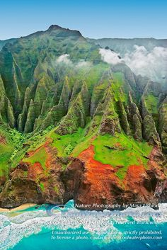 "sheer cliffs of Na Pali coast are sculpted by constant streams of water and rains, producing Kauai's famous ""red dirt"", Kauai, Hawaii, USA, ..."