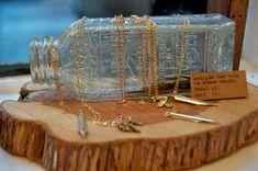 Wood + bottle display, or driftwood on slab, or shell on slab. #luxuryjewelrydisplay