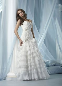 Sweetheart dropped waist A-line organza wedding dress. Everything up until A-line. I want it with mermaid or trumpet and different ruffles