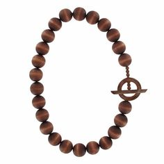Large, wooden beads are dyed a multidimensional mahogany brown and strung on an elastic cord, giving the piece a trendy and tribal feel.  aarikka Louhi Brown Necklace - List: $79 Sale: $63