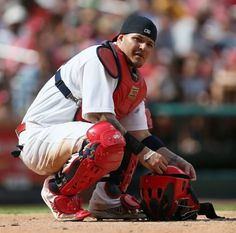 St. Louis Cardinals catcher Yadier Molina adjusts his catchers helmet during a game between the St. Louis Cardinals and the Chicago Cubs on ...