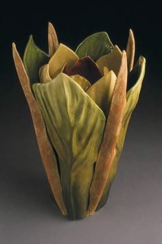 Linda Huey Pottery - Many other vases that feel like the base of a plant; almost old-school Tiffany in feel