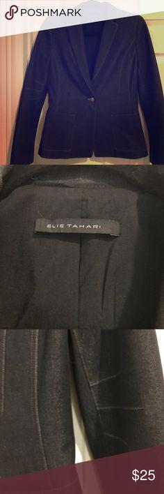 ELLIE TAHARI BLAZER (2) BLACK BLAZER WITH TAN STITCHING DETAILS. EXTERIOR IS IN GREAT CONDITION...INTERIOR HAS MINOR DISCOLORATION RIGHT UNDRR ARM...SEE PHOTO. ELLIE TAHARI Jackets & Coats Blazers