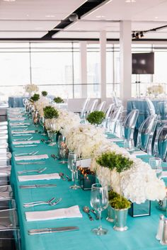Long Table with Tiffany Blue Linens and White Centerpieces  Photography: Vue Photography Read More: http://www.insideweddings.com/weddings/detroit-lions-qb-matthew-staffords-southern-style-rehearsal-dinner/739/