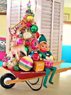 Over The Top Red Wheelbarrow Full Of Whimsical Vintage Christmas Joy
