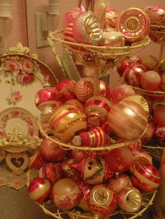 The Pink Monstrosity! Vintage pink Christmas ornaments in tiered wire basket Vintage Pink Christmas, Pink Christmas Ornaments, Merry Christmas, Shabby Chic Christmas, Victorian Christmas, Vintage Ornaments, Little Christmas, Christmas Holidays, Christmas Decorations