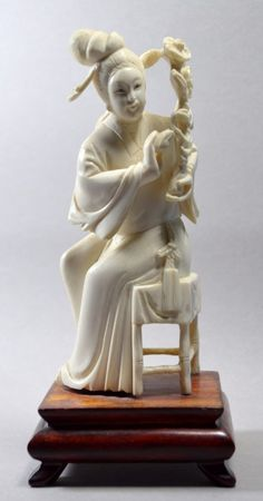 CHINESE CARVED IVORY SEATED FEMALE STATUTE 19TH -20TH C : Lot 88