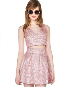 Way cute pink and silver skirt set featuring a matching crop top and miniskirt with brocade all over. Zip closure, fully lined. Looks perfect together or styled separately. *100% Polyester*32