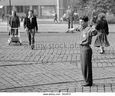 Czechoslovakia - Praha 1949.  Member of Czechoslovak Union of Youth directs traffic at intersection. CTK Vintage Photo - Stock Image