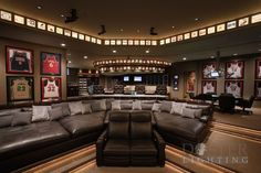 man cave. I would not be opposed to this, watching football in this room!  Just need to replace the basketball jerseys with football ones.