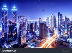 http://image.shutterstock.com/z/stock-photo-dubai-downtown-night-scene-uae-beautiful-modern-buildings-bright-glowing-lights-luxurious-240176458.jpg