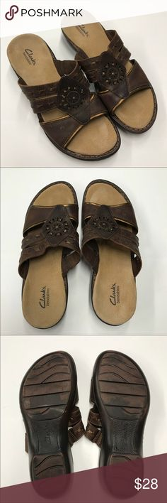 """Clarks Leather Sandals Super cute sandals from Clark's! Brown leather with gold accents and embellishments. Comfy and cushy platform. In perfect condition. Smoke and pet free home. 3.5"""" Wide. 10"""" long.  1.5"""" platform. Clarks Shoes Sandals"""