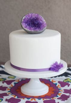 Chocolate cake, chocolate chip mint French buttercream, covered in fondant. Crystal made with isomalt. Completely edible.