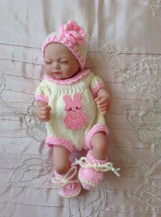 "Hand knitted dolls clothes to fit a 10"" doll/reborn baby/baby doll"