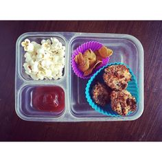 School lunch: organic popcorn, dried mangoes and mini meat loaves (from Against All Grain) with organic ketchup.