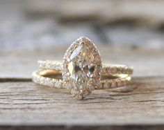 Marquise Diamond Engagement Ring Set in 14K Yellow Gold by Studio1040 on Etsy https://www.etsy.com/listing/182935953/marquise-diamond-engagement-ring-set-in