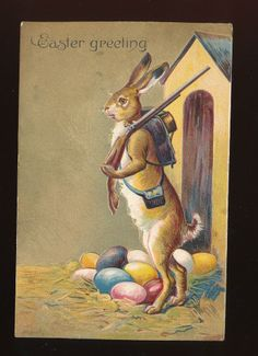 Rabbit with Gun Guards Eggs Antique Gold Embossed Easter Postcard-mmm23