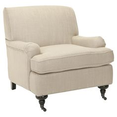 Linen-upholstered arm chair with a birch wood frame and front casters.  Product: Chair    Construction Material: