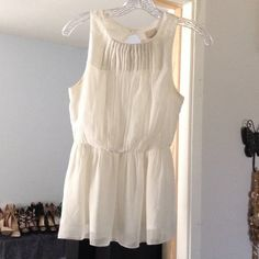 Ivory sleeveless Blouse Worn once, dressy casual look, double lined, beautiful back detail, flares at bottom, can be worn with jeans, shorts, or leggings and some heels. Truly a must have in your closet.     Welcome to my closet  Reasonable OFFERS are welcomed   No Trades on this item  I do bundles   Fast Shipping  Pet free home ♨️ Smoke free home  Contact me before buying Ill change the price for discounted shipping  Thank you for visiting my closet! H&M Tops Blouses