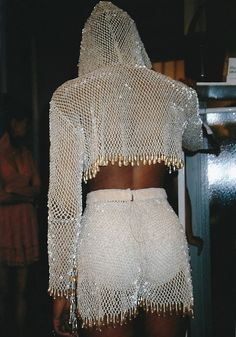 Shiny diamond crystals . white / silver sequins hoodie and shorts look really dramatic...but where to wear them? Some night out?