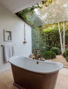 The bath tub in the master suite at Patina Farm is situated in front of a large window to the garden. Bathroom Plants, Small Bathroom, Master Bathroom, Bathroom Ideas, Clawfoot Tub Bathroom, Bathtub Decor, Garden Bathroom, Boho Bathroom, Bathroom Designs