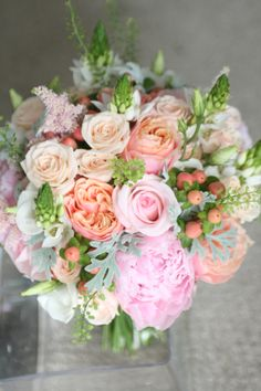 Wedding bouquet in peach and pink with vuvuzela roses, sweet akito roses, spray roses, hypericum, peony, ornithogalum, eustoma, thlaspi and senecio. www.libertyblooms.co.uk
