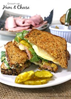 Carving board ham, creamy gooey goodness of havarti cheese, sweet pickles, and a spicy brown mustard and honey spread all on organic and delicious wheat bread, grilled to perfection! Grown-up Ham and Havarti Grilled Cheese #ad #gooeygoodness