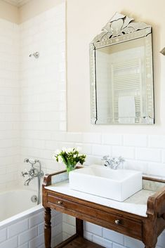 Classic bath with Venetian mirror.