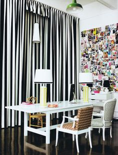 b+w curtains, white desk, glossy black floor and huge pin up wall