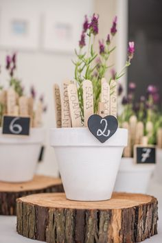 Find your seat! Planter sticks in a flower pot. Adorable!