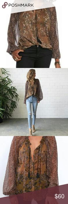 SALE!! Free People Hendrix Printed Blouse Sz M, black combo. Colors are olive, black and a touch of red. Slightly sheer. Oversized fit. Adorable tassel detail at neckline. Free People Tops Tunics