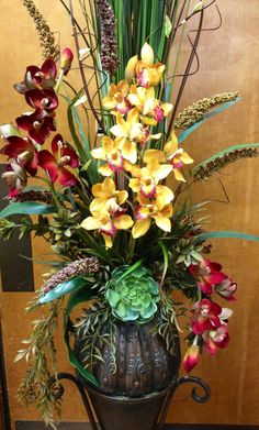 #Orchid arrangement in metal vase. Designed by Arcadia Floral & Home Decor