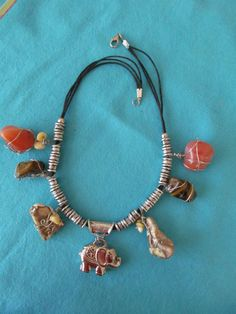 Items similar to African healing semi precious stones necklace. Carnelian, silver plated elephant charm on Etsy Handmade Jewelry, Unique Jewelry, Handmade Gifts, Selling Jewelry, Stone Necklace, Stones, Healing, African, Charmed