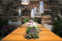 Tip: Drill holes into galvanized French flowerpots to turn them into hanging pendant lamps! - 2012 Philadelphia Flower Show #gardens #flowers #plants