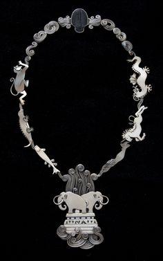"Necklace | Ahlene Walsh.  ""Intelligent Design"".  Sterling silver and trilobite."