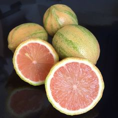 Younger Pink lemons are variegated, with green and off white stripes on the outside, and a rosé hued pink flesh inside. Pink lemons have a tangy and tart flavor, a rich lemon scent and very few seeds if any.