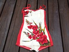 Vintage swimming suit 1950's Those flowers and color blocked sides are amazing!