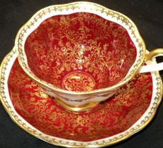 Royal Albert Teacup and Saucer, Burgundy and Gold Cup Interior and Saucer, Exterior of Scalloped Cup and Saucer Band are White with Gilt Trim