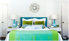 Pick A Pair.  There are many color pairings that always work well together, hot pink + turquoise, yellow + gray, orange + blue, lime green + teal blue, coral + citron, gray + pink, the list goes on!  Pick two colors you love that also work together, and pull both of those colors into your home with accessories and art.
