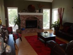 Formal Living Room With Brick Fireplace Chairs South Africa Red Decor Designs Decorating Ideas Hgtv