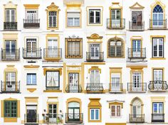 Windows in Evora, Portugal     Meanwhile, the windows in Evora, Portugal, can be seen featuring a colour common theme of mustard yellow, pale yellow and white