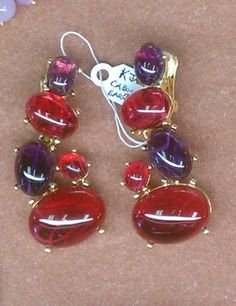 We LOVE these dramatic, dangling, red and violet cabochon earrings by Kenneth J Lane. SOLD