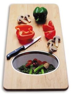 Over the sink cutting board. This would be SUCH a small kitchen space saver.