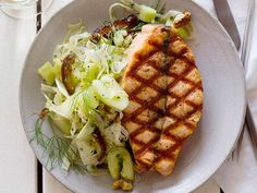 Grilled Salmon with Smashed Cucumber-Date Salad recipe from Geoffrey Zakarian via Food Network