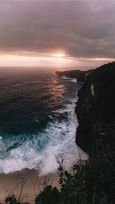 seashore across horizon during cloudy sunset iPhone Wallpapers