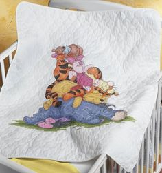 $45.00 Baby Janlynn Stamped Cross Stitch Kit, 43-1/2-Inch by 34-Inch, Snoozy Day Quilt - Eeyore, Pooh, Tigger, Piglet and Roo are fast asleep on a patch of cool grass. This design will delight any youngster and encourage them to take a nap with their friends from the Hundred Acre Woods. A free Disney gift card and envelope included for gift giving purposes. Kit Contains, one screen printed, 50%  ...