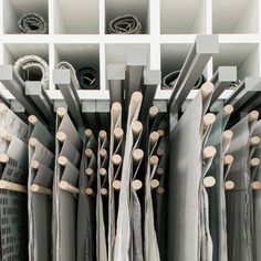 I love this hanging scroll style as a way of displaying printed fabrics or papers :: About - Showrooms – Kinnasand