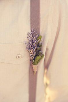 little lavender sprig pinned onto a suspender strap